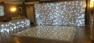 Restaurant white dance floor & starcloth