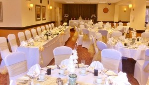 Savoy Suite wedding showing top table, stage in background